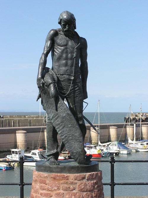 A statue of 'The Ancient Mariner' with the albatross around his neck.